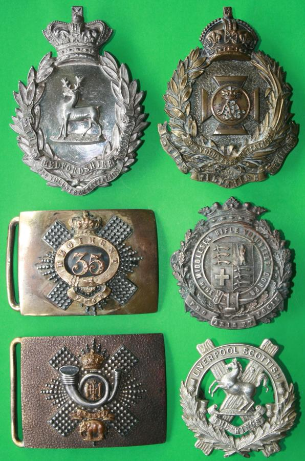 CROSS BELT BADGES AND BELT BUCKLES