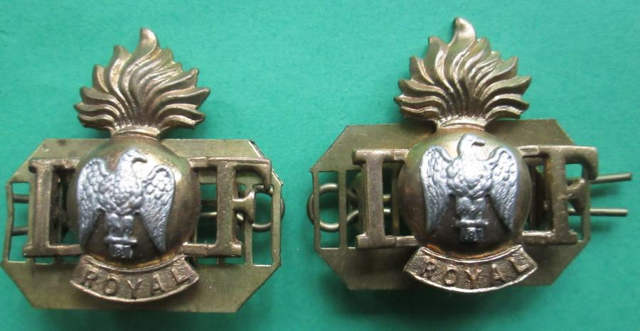 A PAIR OF ROYAL IRISH FUSILIERS SHOULDER TITLES