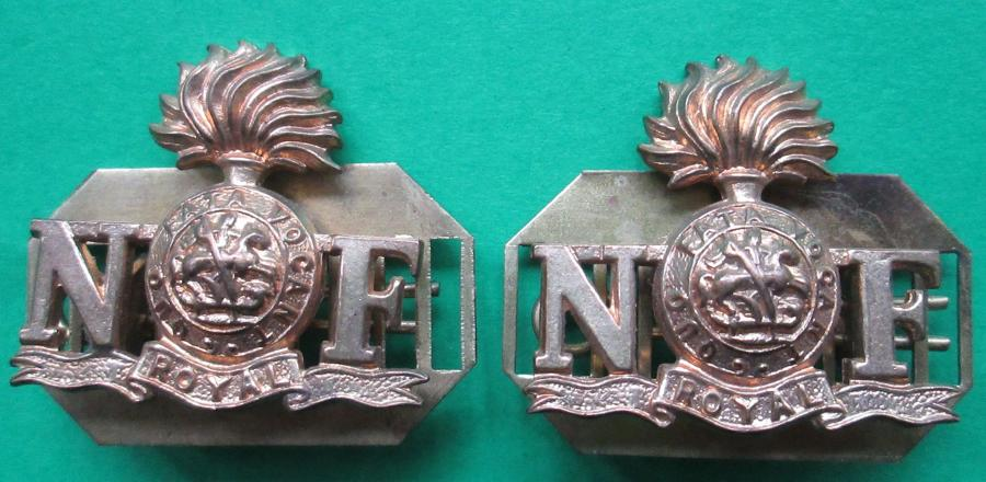 A MATCHING PAIR OF ROYAL NORTHUMBRIAN FUSILIERS SHOULDER TITLES