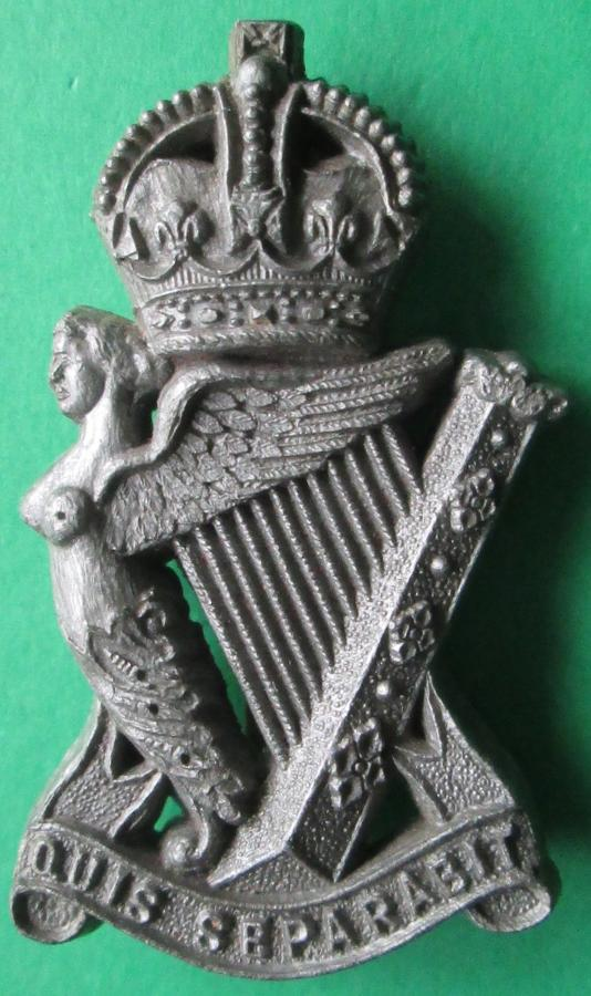A WWII PLASTIC ROYAL IRISH RIFLES CAP BADGE