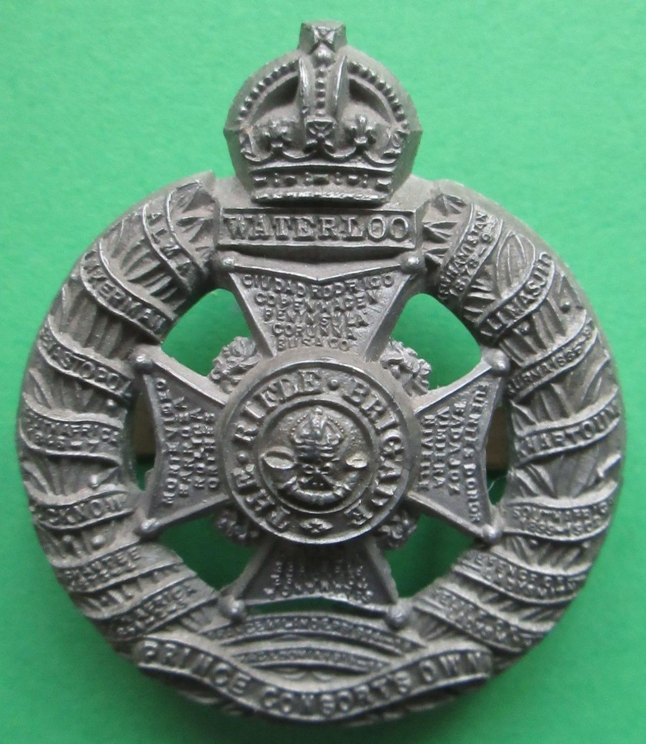 A PLASTIC RIFLE BRIGADE WWII CAP BADGE