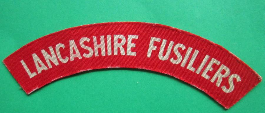 A WWII PRINTED LANCASHIRE FUSILIERS SHOULDER TITLE
