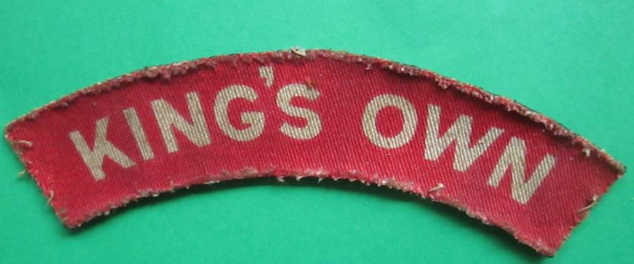 A WWII PRINTED KINGS OWN SHOULDER TITLE USED