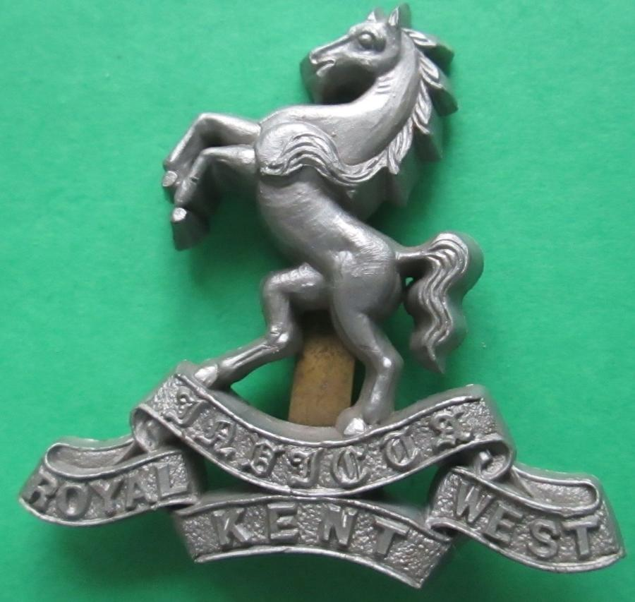 A WWII PLASTIC ROYAL WEST KENT REGT CAP BADGE
