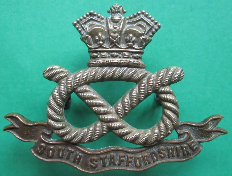 A VICTORIAN OTHER RANKS SOUTH STAFFORDSHIRE CAP BADGE
