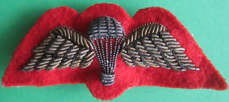 A RED BACKED BULLION WIRE JUMP WING