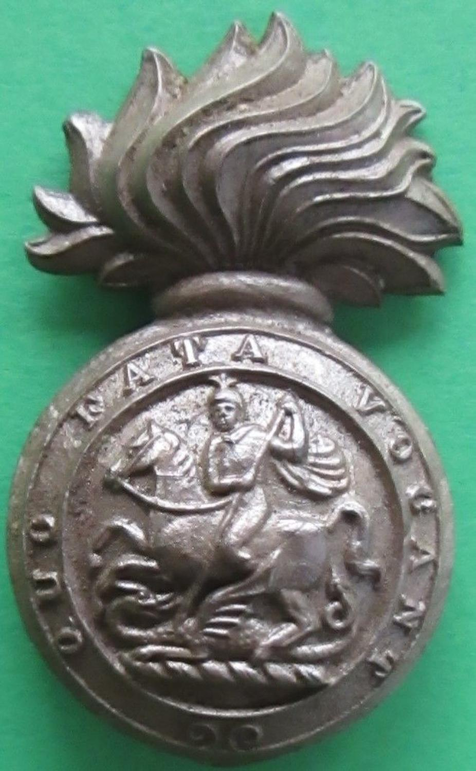 A WWII PLASTIC ROYAL NORTHUMBERLAND FUSILIERS CAP BADGE