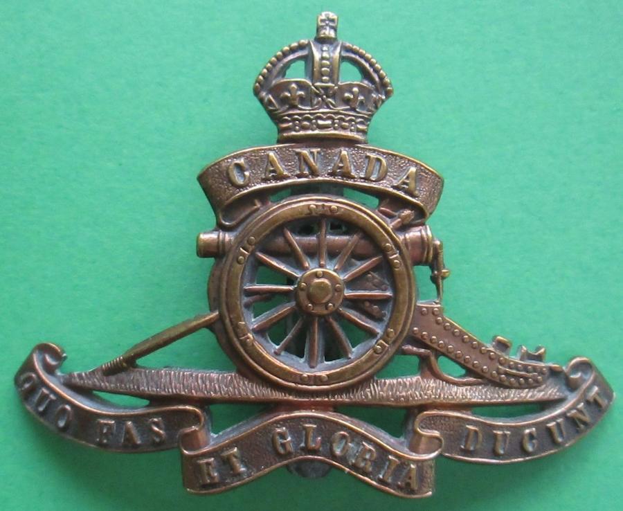 A WWII CANADIAN ROYAL ARTILLERY CAP BADGE