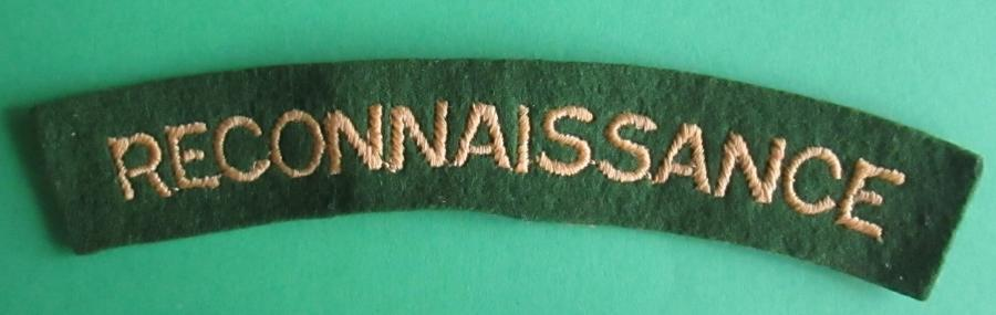 A WWII EMBROIDERED RECONNAISSANCE CORPS SHOULDER TITLE
