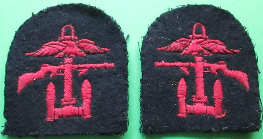 A WWII PAIR OF TOMB STONE COMBINED OPERATIONS BADGES