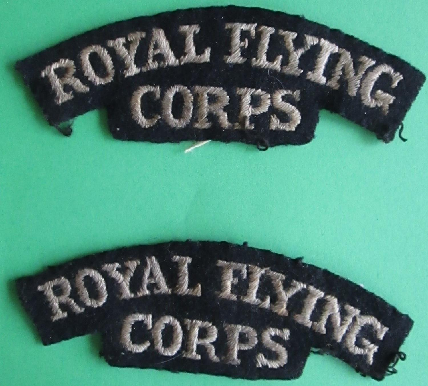 A WWI PAIR OF ROYAL FLYING CORPS SHOULDER TITLES