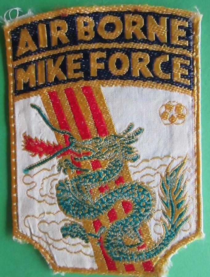 A RARE VIETNAM MADE MIKE FORCE BADGE
