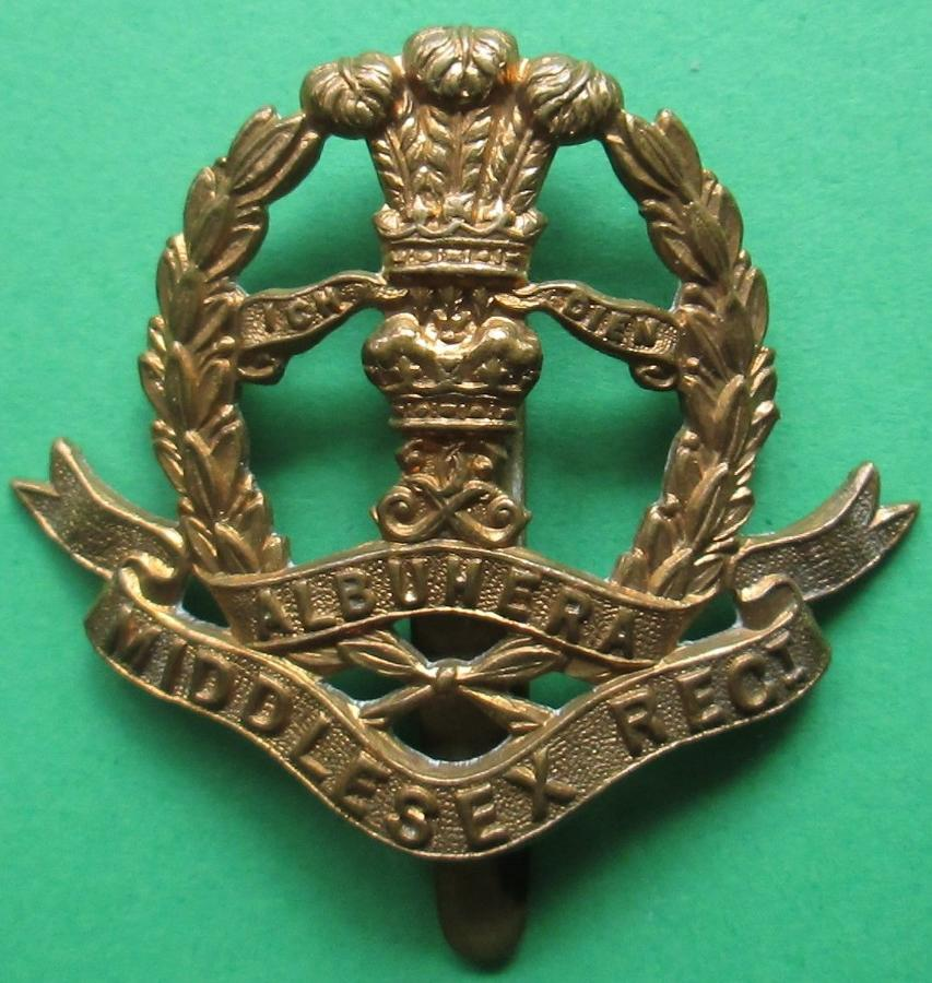 A WWI MIDDLESEX ECONOMY REGT CAP BADGE