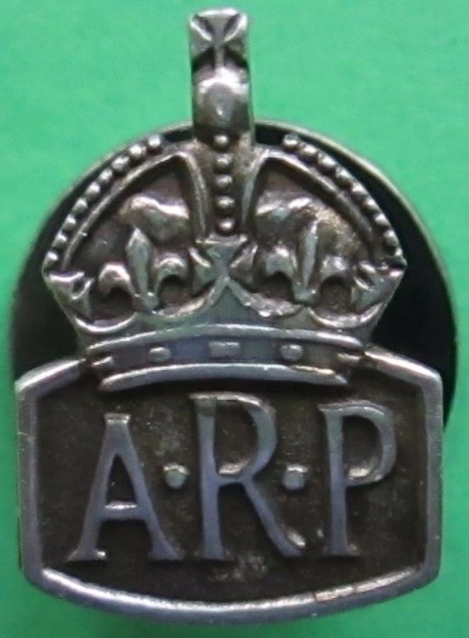 A SMALL SILVER ARP LAPEL BADGE ( MANS EXAMPLE )