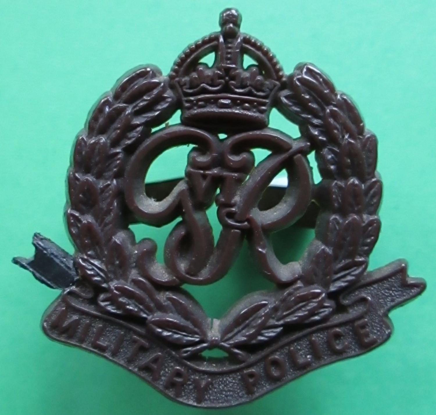 A WWII PLASTIC MILITARY POLICE CAP BADGE
