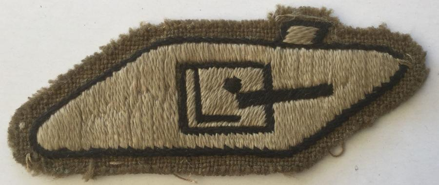 A WWII TANK CREWMAN'S ARM BADGE