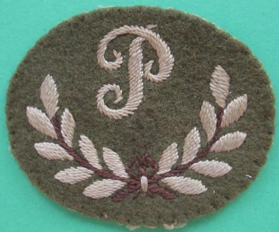 A GOOD WWII ROYAL ARTILLERY PLOTTERS P TRADE BADGE