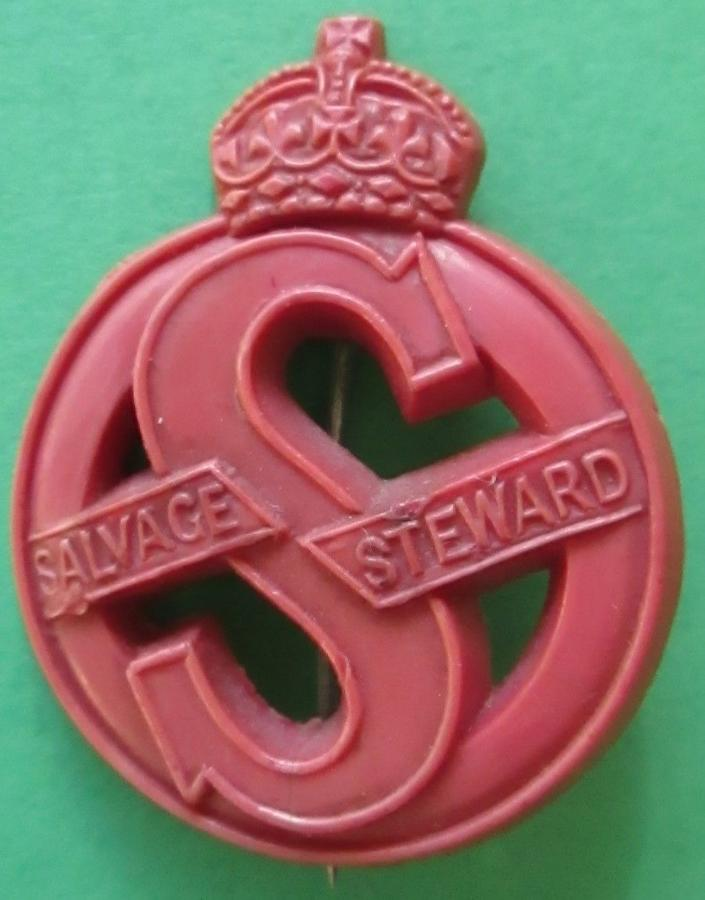 A WWII RED PLASTIC SALVAGE STEWARDS PIN BADGE