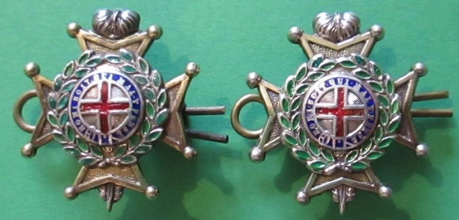 A GOOD PAIR OF THE OFFICERS SILVER PLATED SUSSEX REGT COLLARS