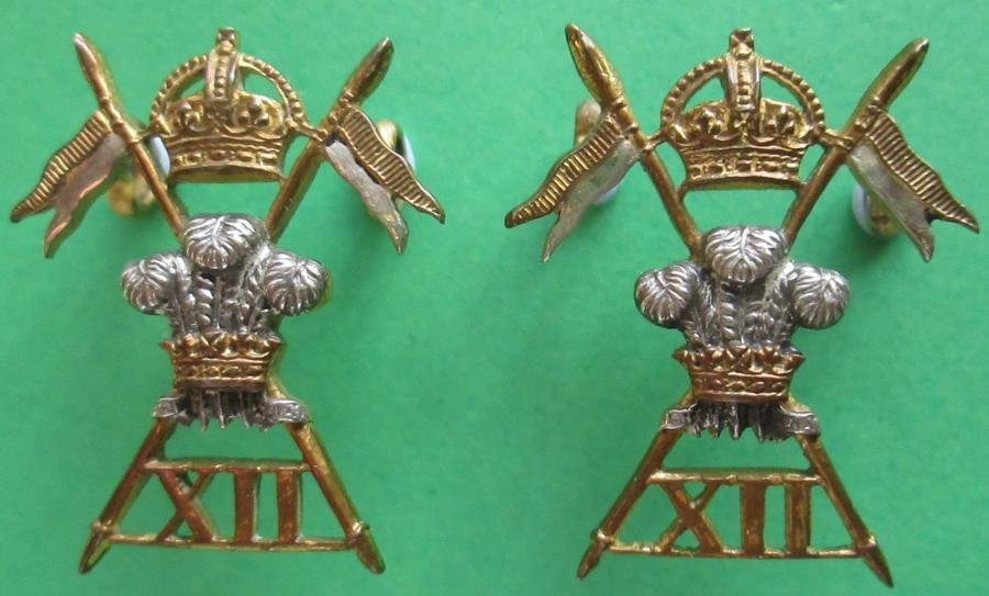 A MATCHING PAIR OF 12th LANCERS OFFICERS SILVER AND GILT COLLAR BADGES