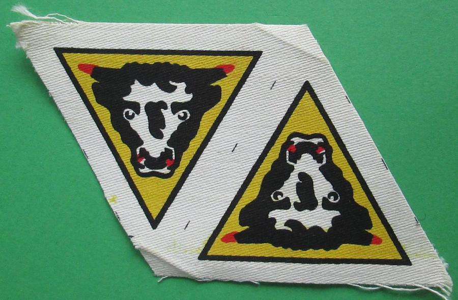 A MINT UNCUT PAIR OF 79th ARMOURED DIVISION FORMATION SIGNS