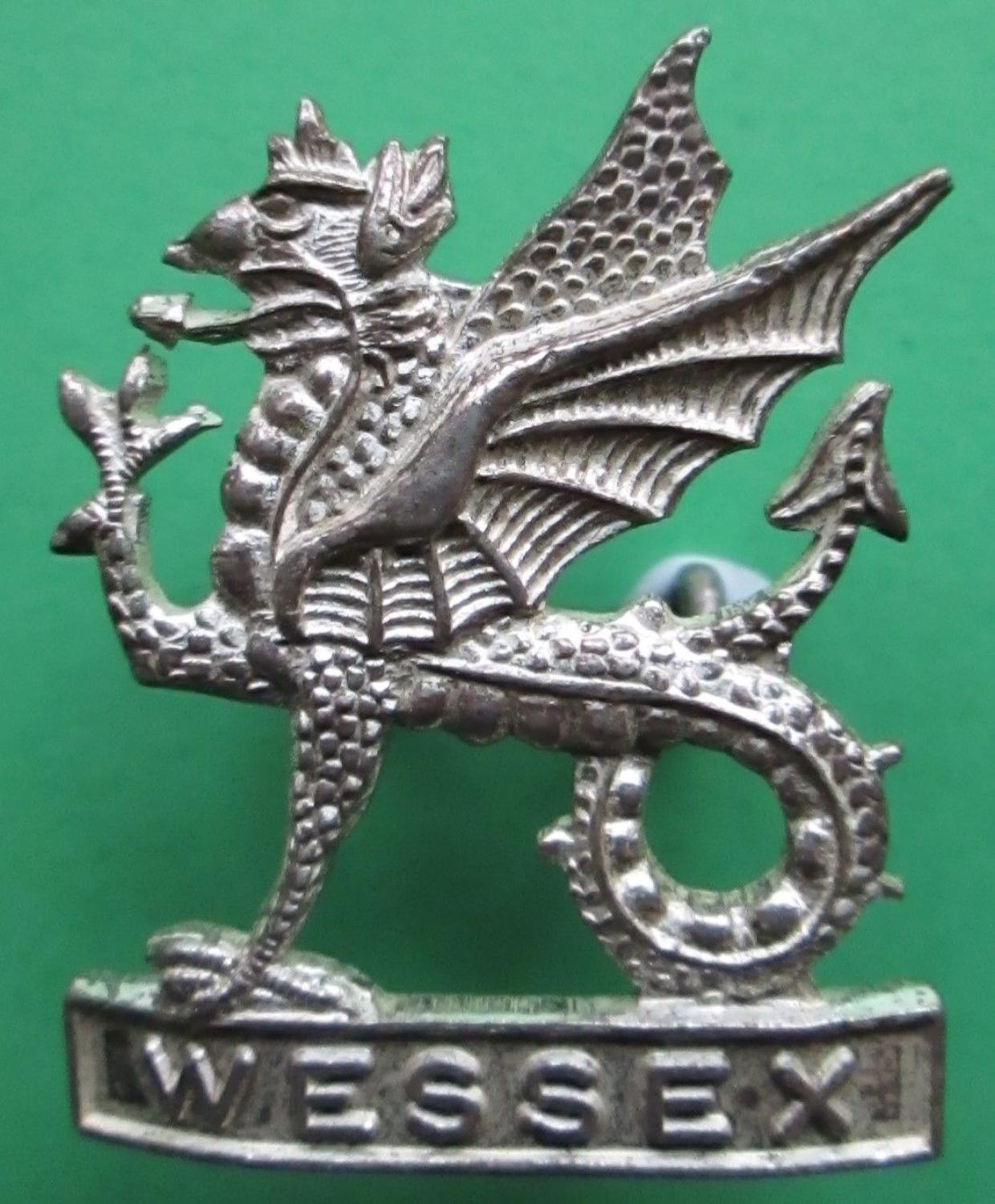 A SILVER PLATED WESSEX TERRITORIAL REGT CAP BADGE