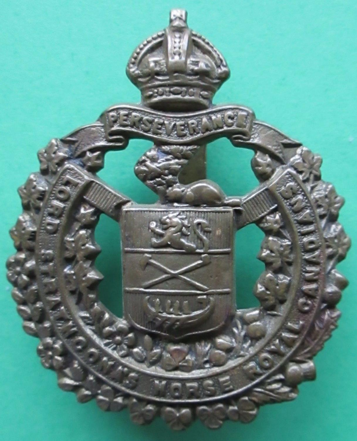 A LORD STRATHCONA'S HORSE ROYAL CANADIANS CAP BADGE