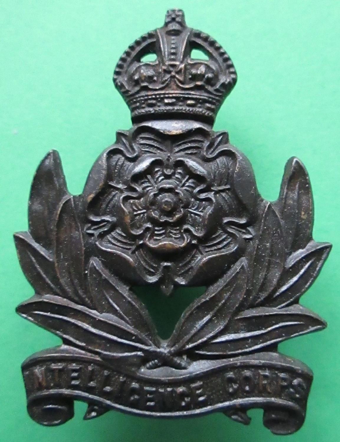 A PRE 1952 INTELLIGENCE CORPS OFFICERS BRONZE CAP BADGE