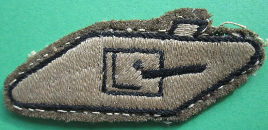 A WWII TANK DRIVERS ARM BADGE