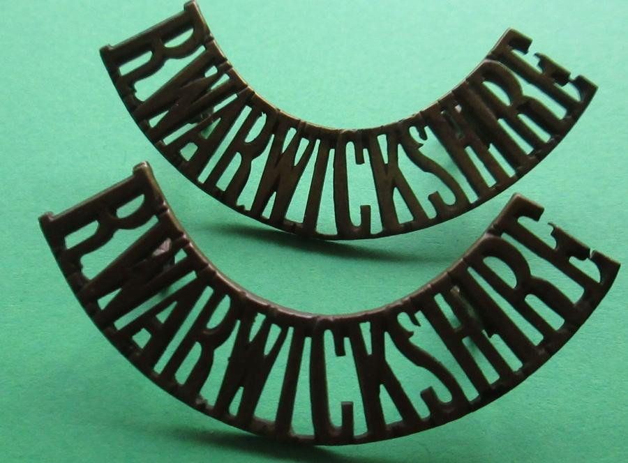 A PAIR OF ROYAL WARWICKSHIRE METAL SHOULDER TITLES