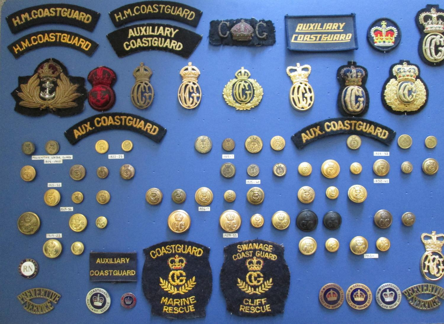 A COLLECTION OF H M COAST GUARD BADGES AND BUTTONS