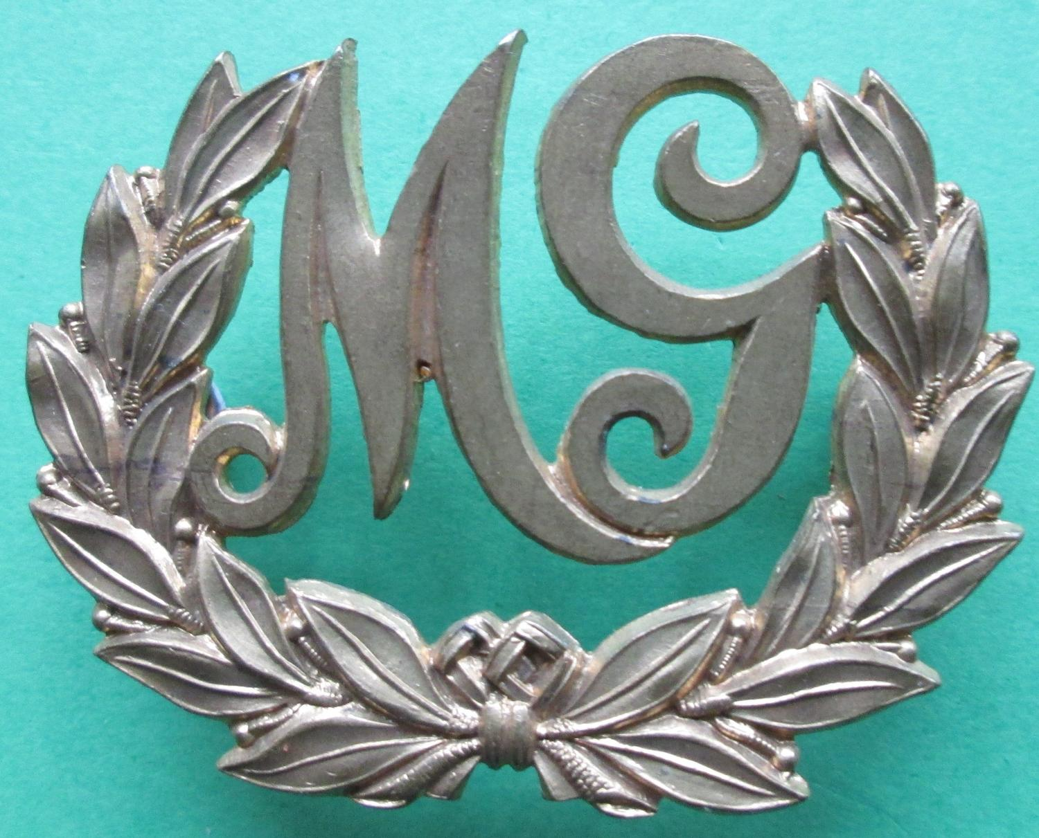 A MACHINE GUNNERS METAL TRADE BADGE