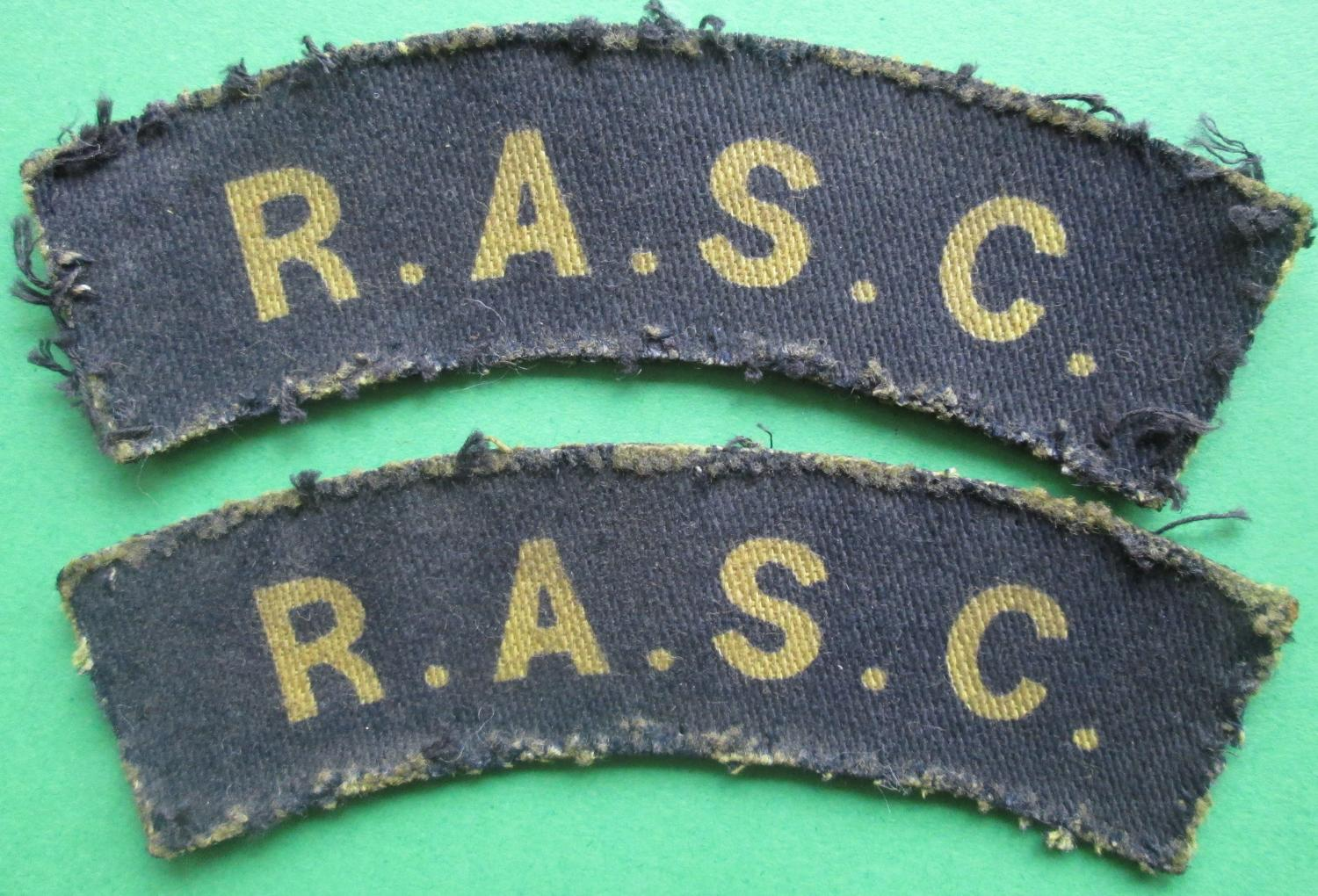 A PAIR OF ROYAL ARMY SERVICE CORPS TITLES