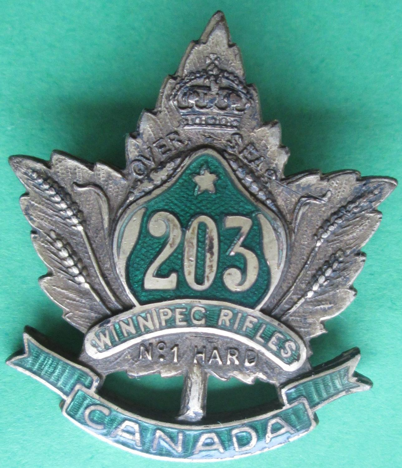 A CANADIAN PIN BADGE FOR THE WINNIPEG RIFLES 203