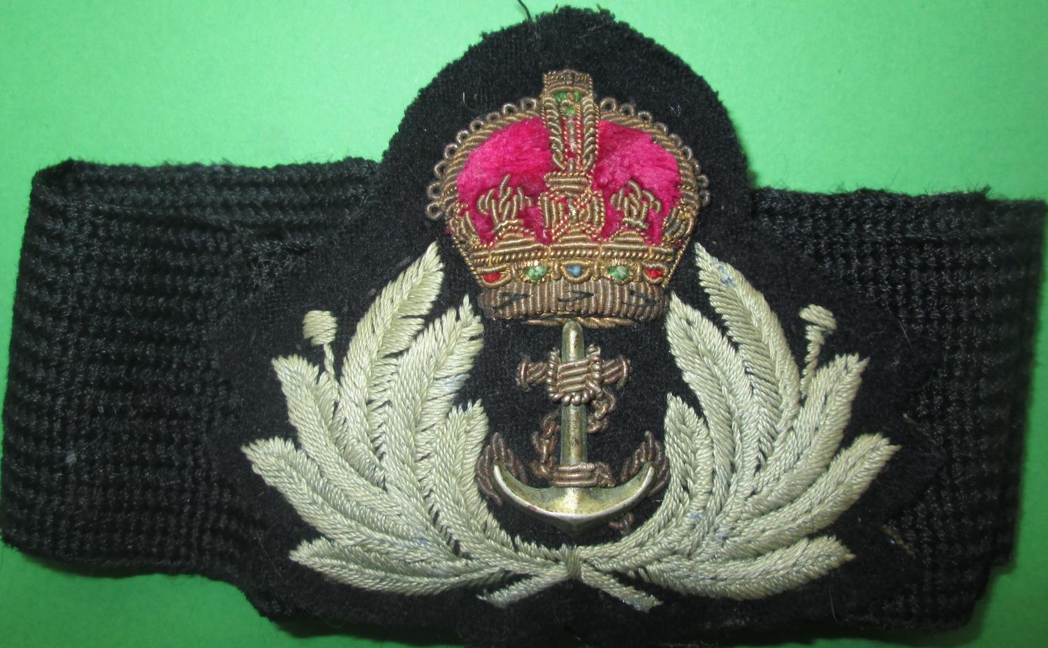 A PRE 1952 KINGS CROWN WOMAN'S ROYAL NAVY SERVICE CAP BADGE