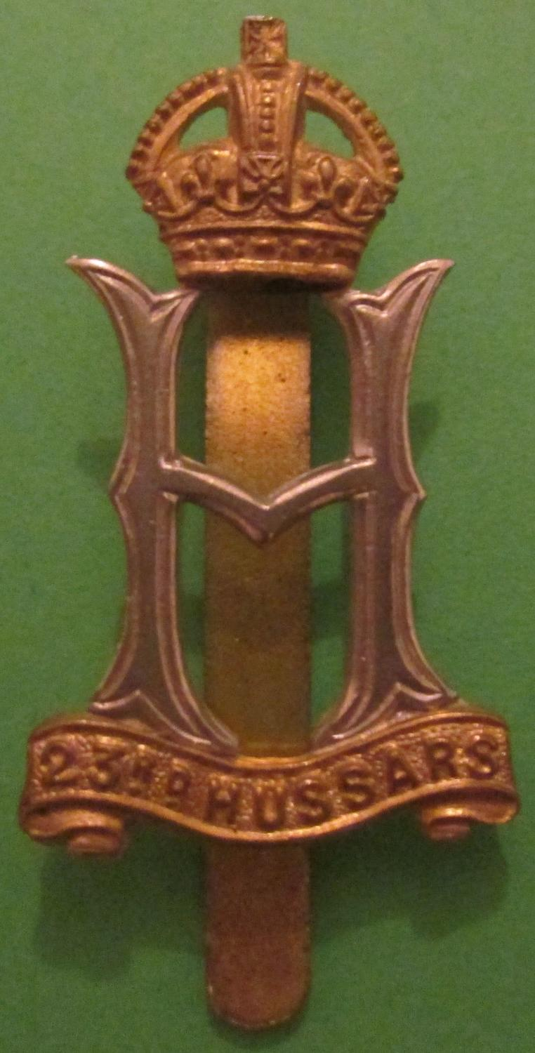 A WWII 23RD HUSSARS CAP BADGE