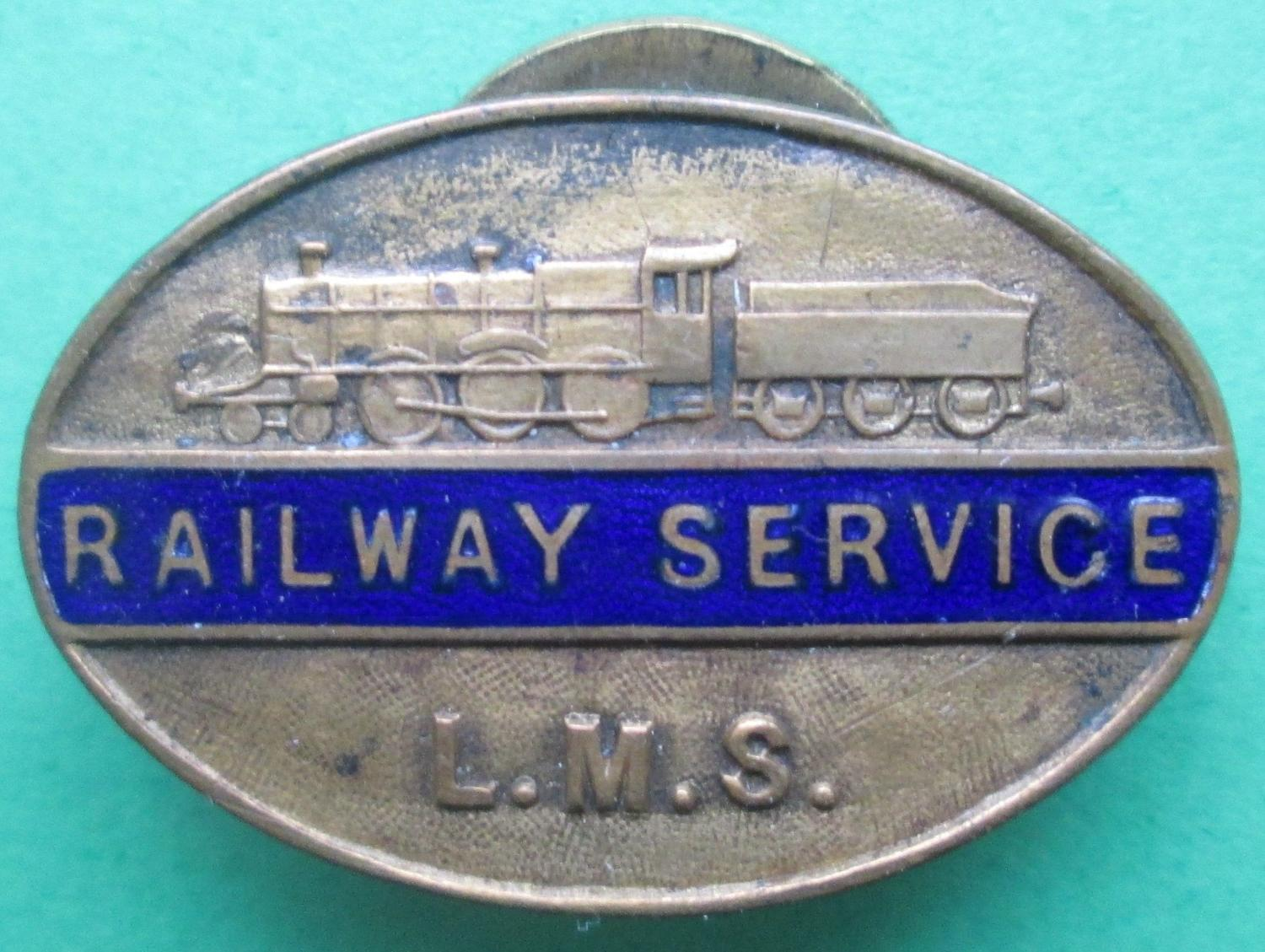 A LONDON MIDLAND SCOTTISH RAILWAY SERVICE LAPEL BADGE