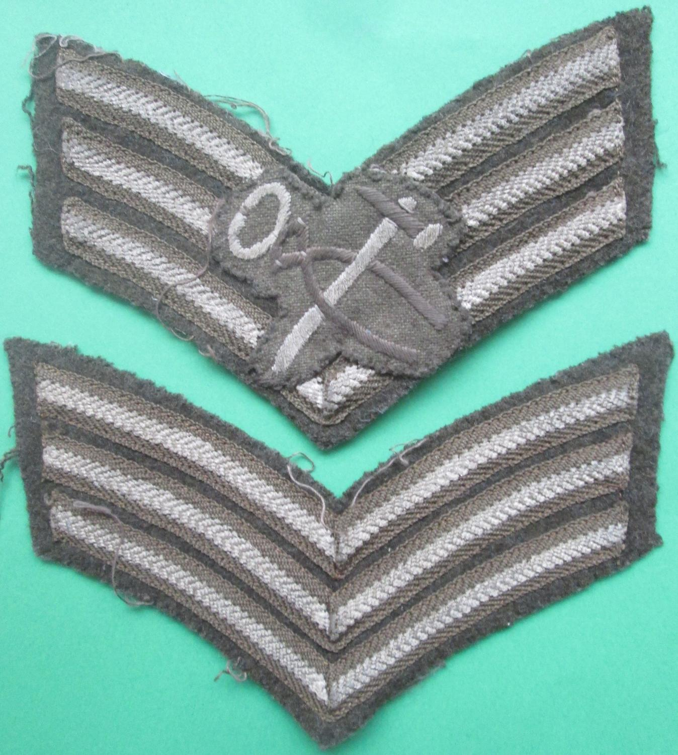 A MATCHING PAIR OF WWII SGTS STRIPS WITH A ARMOURS BADGED ATTACHED