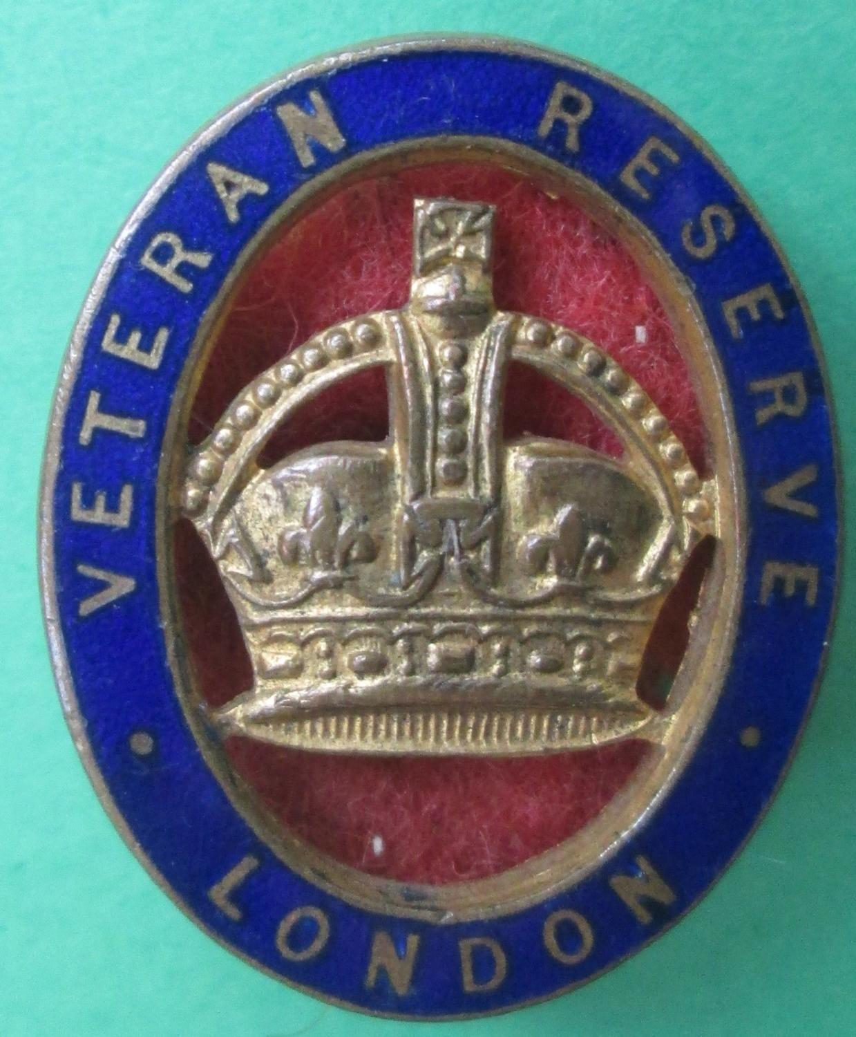 A VETERAN RESERVE LAPEL BADGE