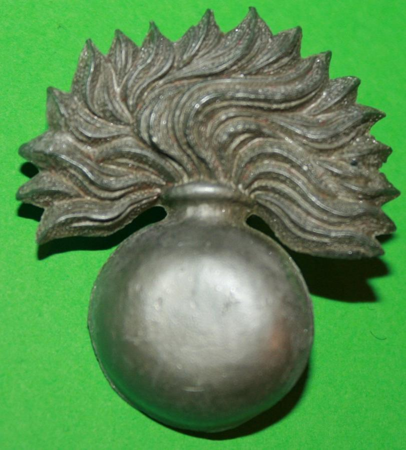 A WWII ECONOMY PLASTIC COLDSTREAM GUARDS CAP BADGE
