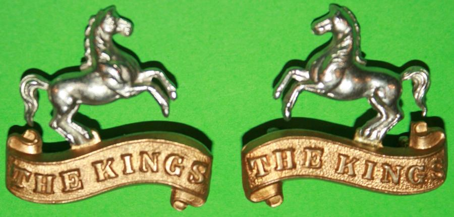 A GOOD MATCHING PAIR OF THE KINGS LIVERPOOL REGT OR'S COLLAR BADGES