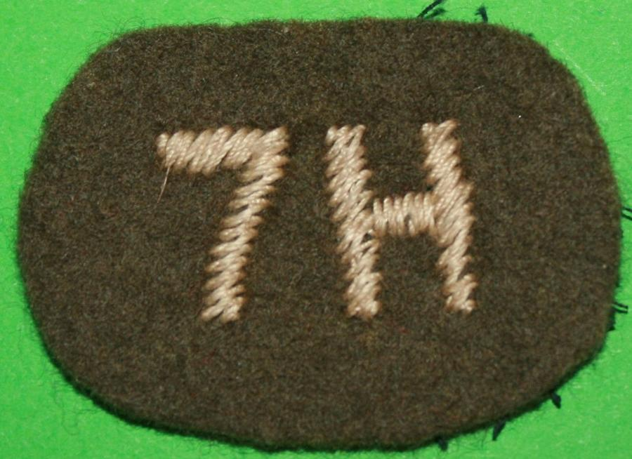 A WWII 7th HUSSARS SHOULDER TITLE