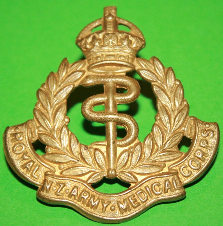 A WWII PERIOD ROYAL CANADIAN ARMY MEDICAL CORPS CAP BADGE