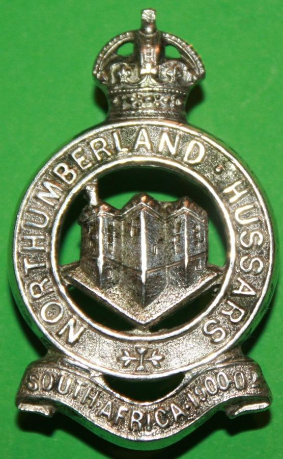 A SILVER PLATED NORTHUMBERLAND HUSSARS CAP BADGE