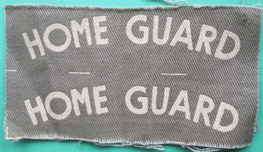 AN UNCUT PAIR OF PRINTED HOME GUARD SHOULDER TITLES