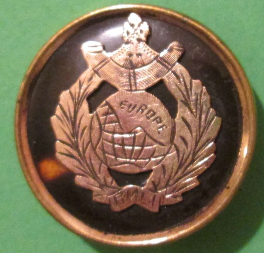 A GOLD FRONTED ROYAL MARINE LIGHT INFANTRY TORTOISE SHELL BADGE