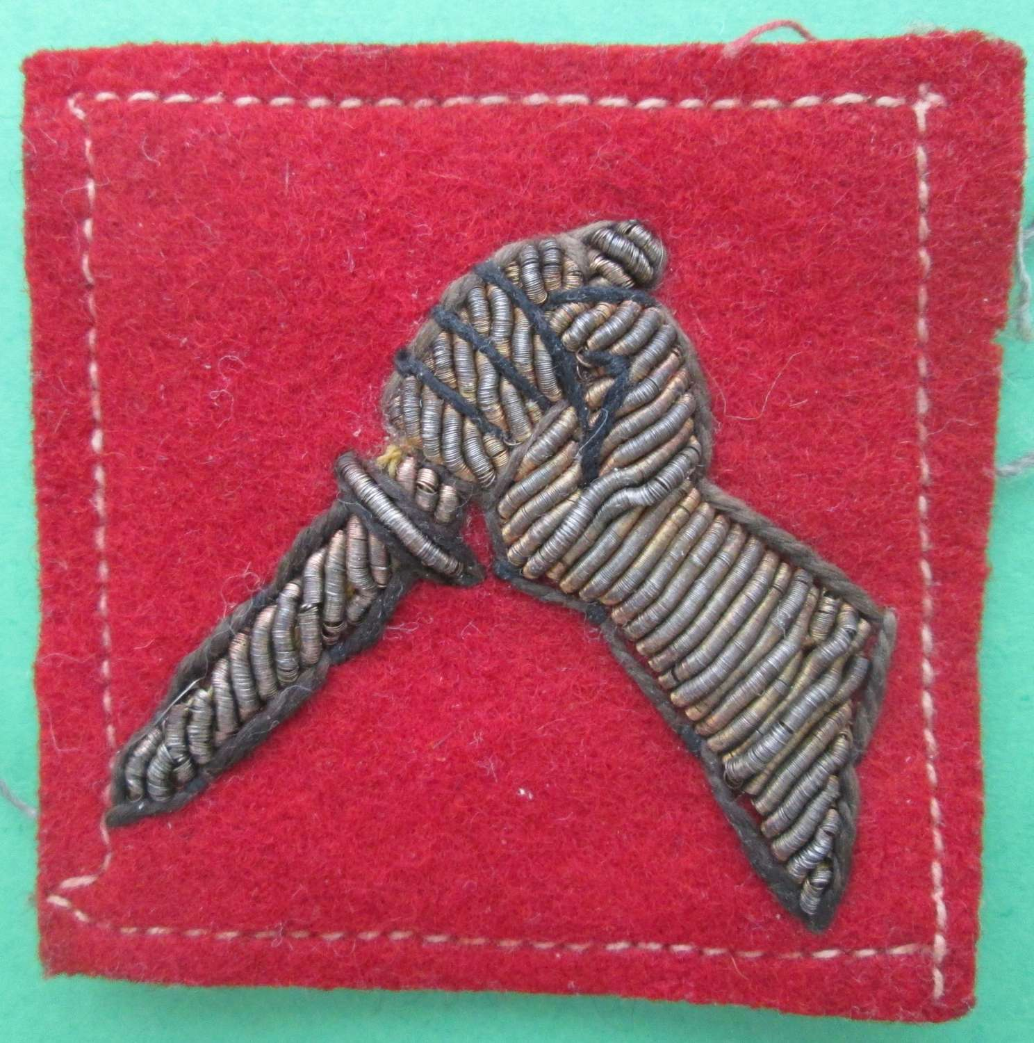 A 19TH INDIAN DIVISION FORMATION SIGN IN BULLION WIRE