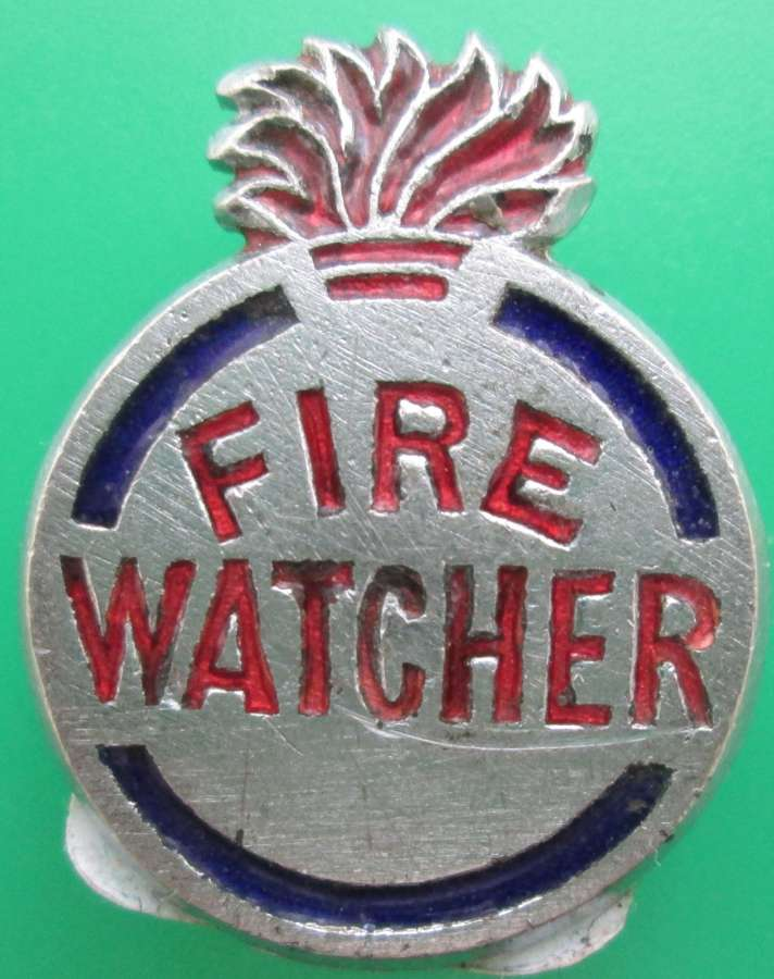 A WWII PERIOD FIRE WATCHERS BADGE