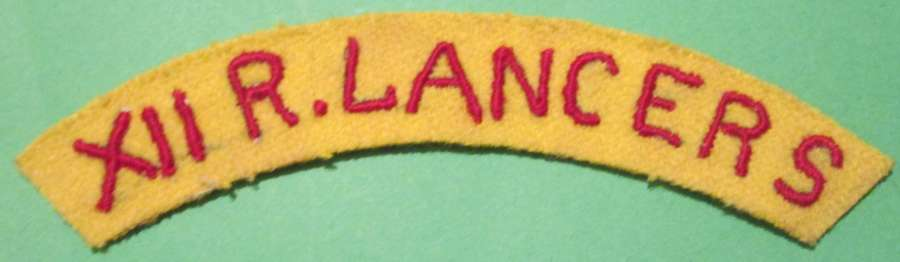 A SCARCE LATE WAR 12th ROYAL LANCERS RED AND YELLOW SHOULDER TITLE