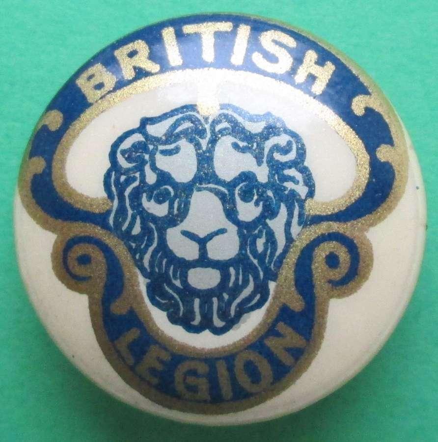 A BRITISH LEGION BUTTON HOLE BADGE